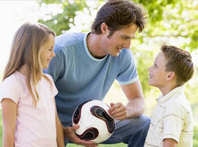 dad-school-age-son-and-daughter-soccer-ball